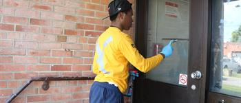 YouthWorx member clean windows in Lawrence Heights