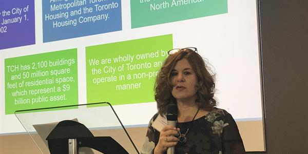 Toronto Community Housing's Vice President of Information Technology Services, Luisa Andrews speaking to industry professionals.