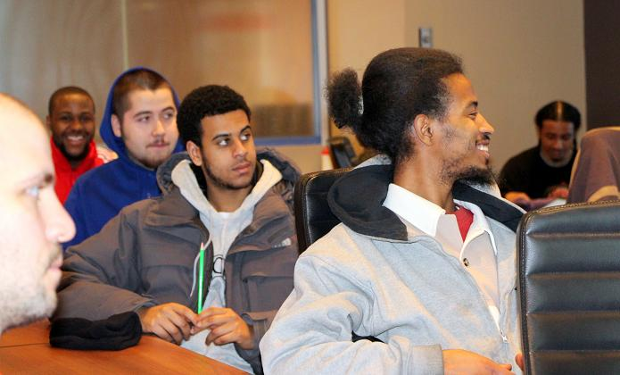 Youth share a light-hearted moment during their information session.