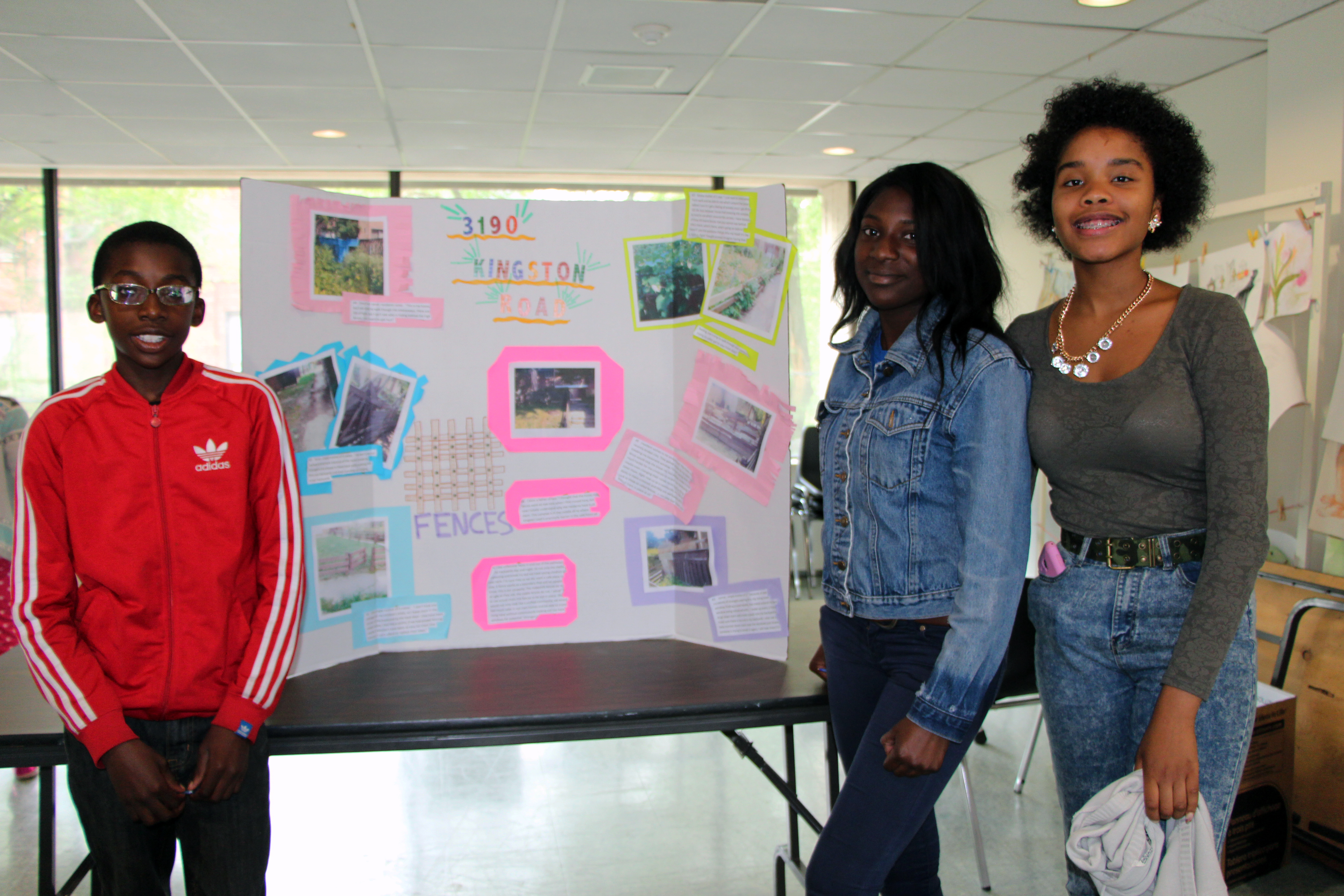 Toronto Community Housing Youth stand with their safety project poster