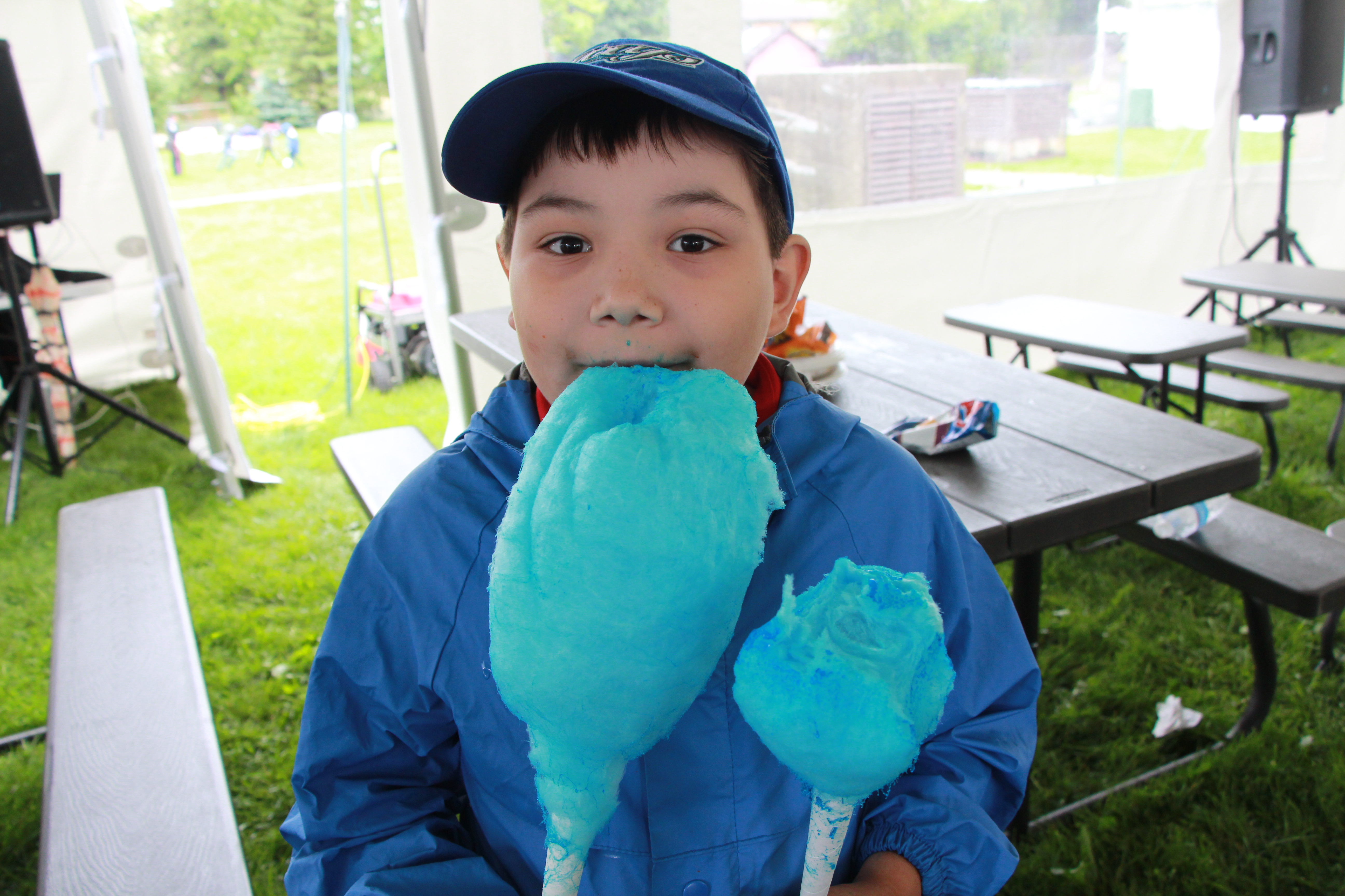 Photo: Matthew enjoying his cotton candy in a dry spot under the tent.