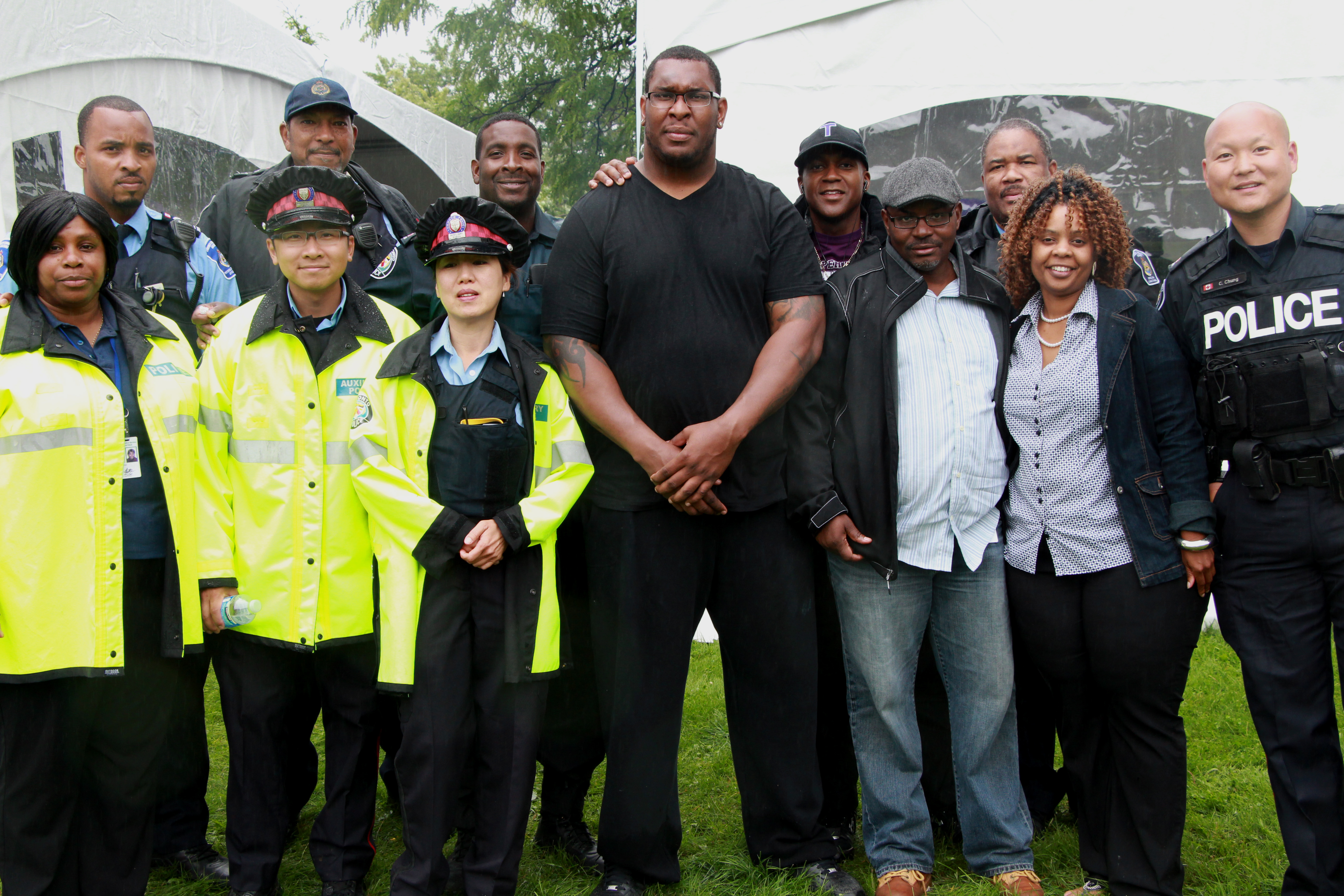 Photo: Orlando Franklin (middle) with staff from the Toronto Police Service and Toronto Community Housing�s Community Housing Safety Unit.