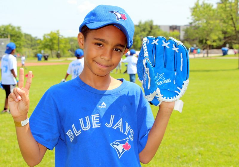 A Rookie League participant takes a break from the baseball drills