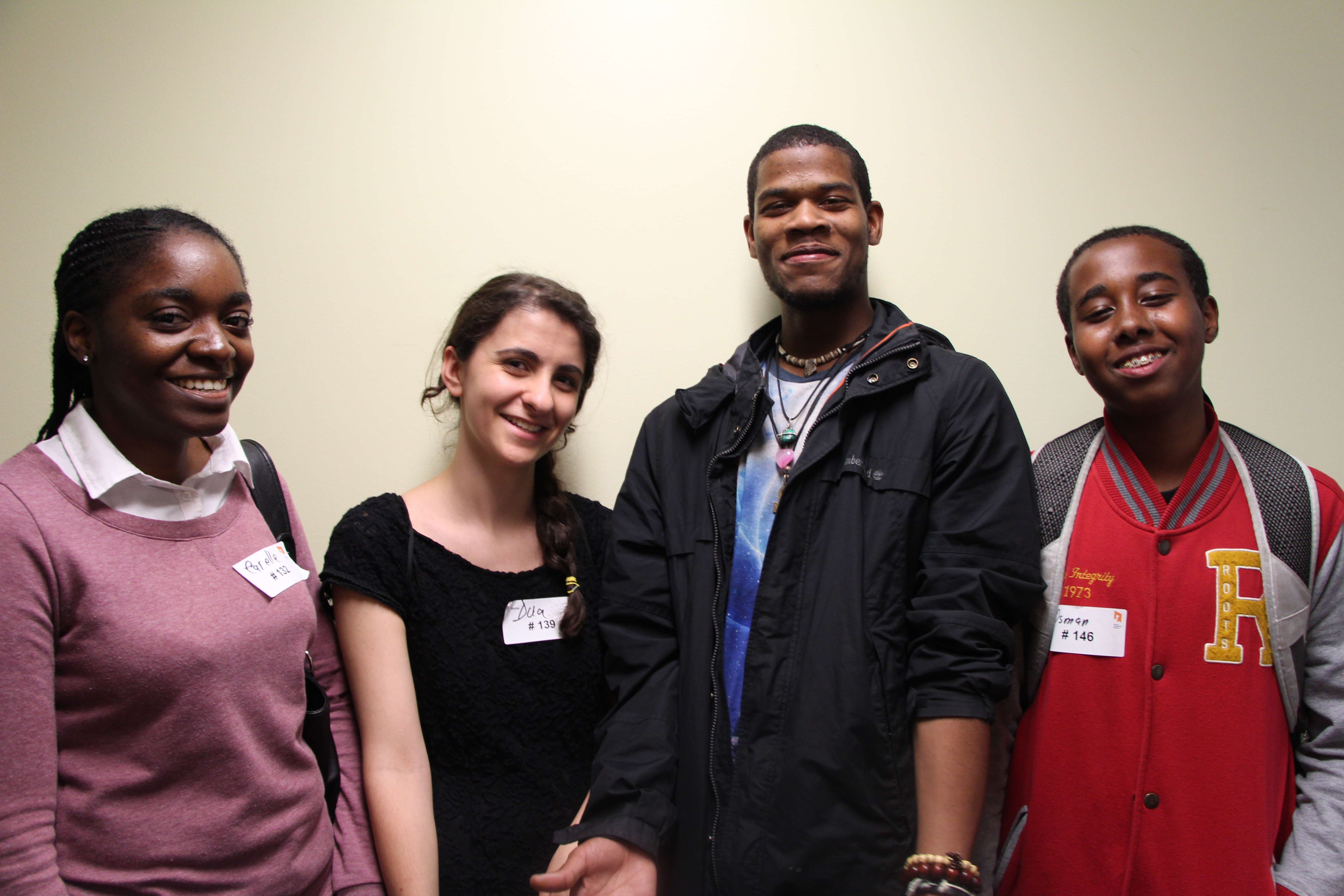 Group of four youth smiling after their interviews for YouthWorx