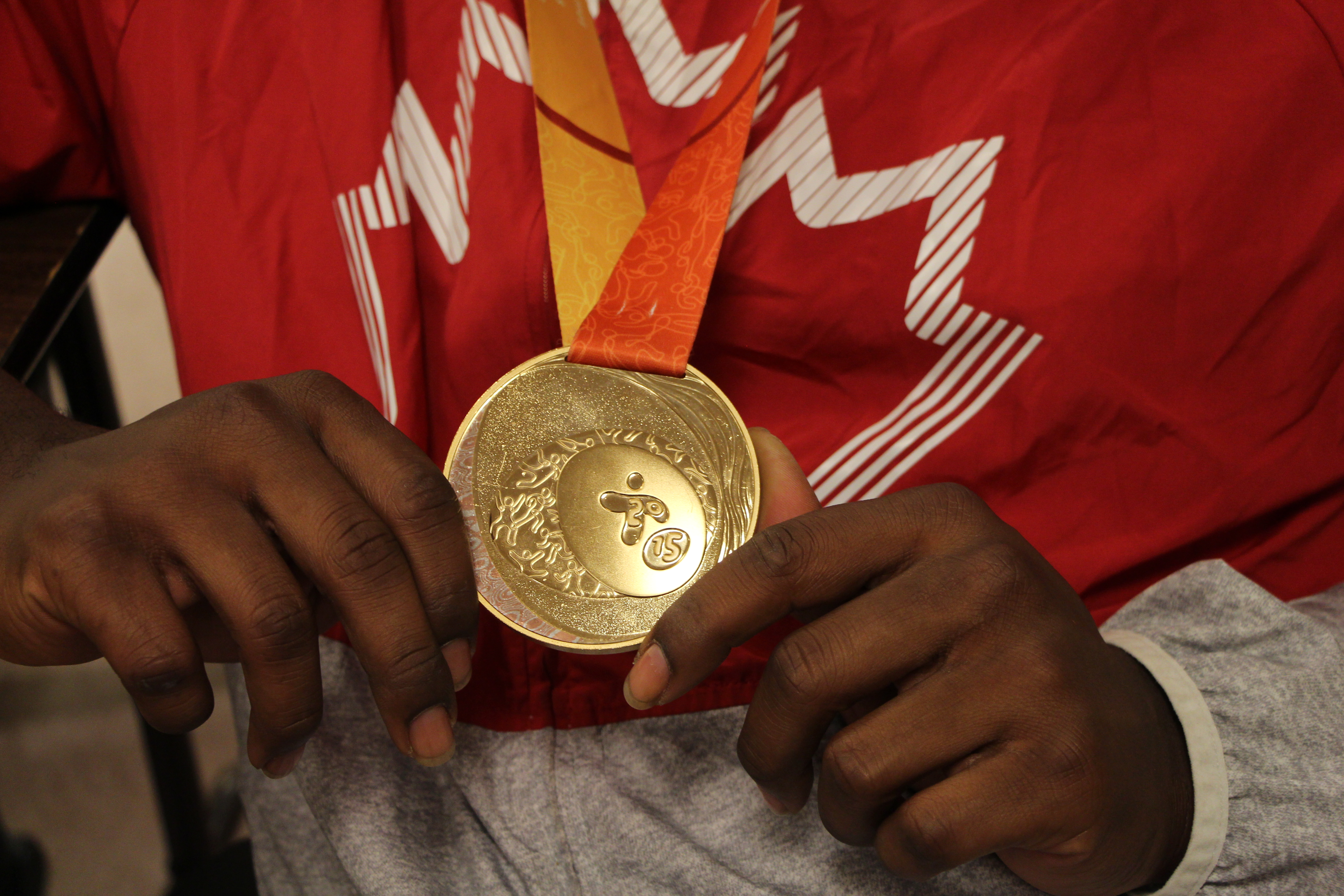 Jason showing off the gold medal that he won in F32-34 men�s shot put during the 2015 Parapan Am Games.