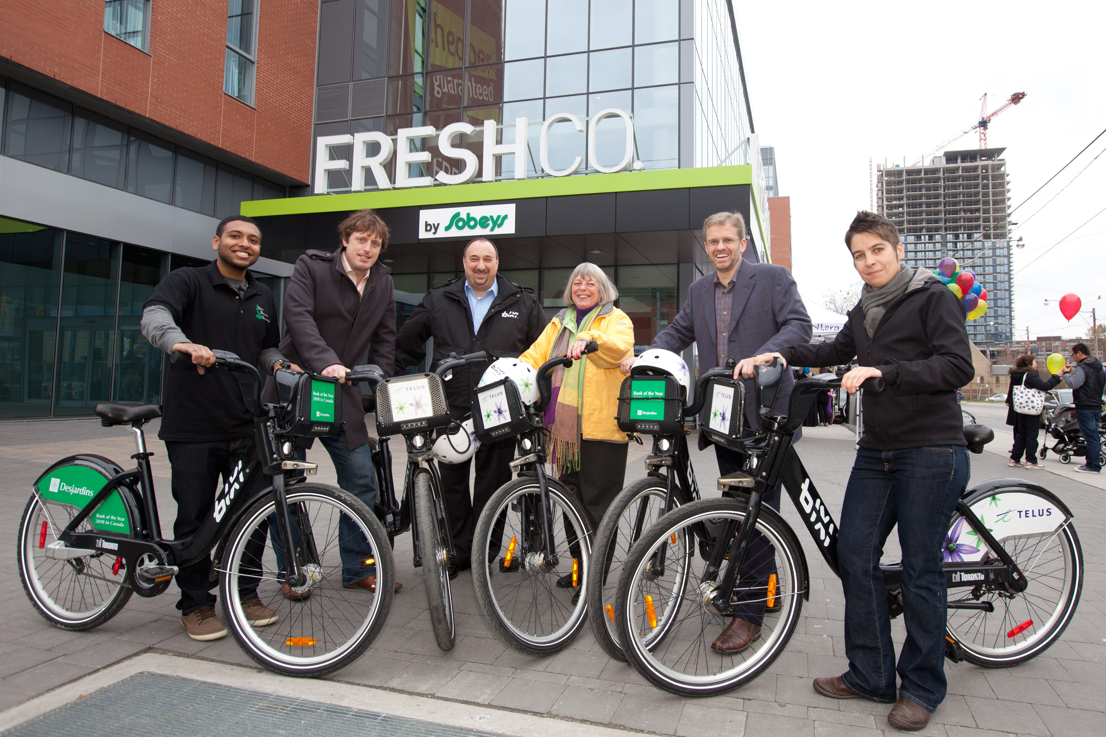 Ready to roll (left to right) are tenant Amzad Khan, Director of the Regent Park revitalization Tom Burr, BIXI Toronto Operations Manager Michael Felice, Councillor Pam McConnell, Daniels Corporation Vice-President Martin Blake and area resident Cheryl Christensen.