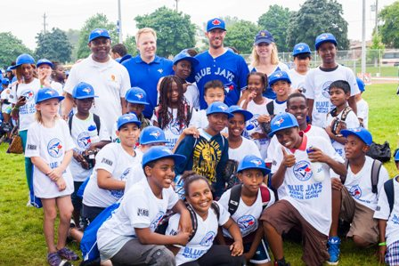 Back row- (left) Eugene Jones Jr., Toronto Community Housing CEO, Rob Drynan, Executive Director, Jays Care Foundation, Blue Jays Catcher, J.P. Arcencibia, and Jennifer Wood, Toronto Community Housing Board member, pose with a group of participants.