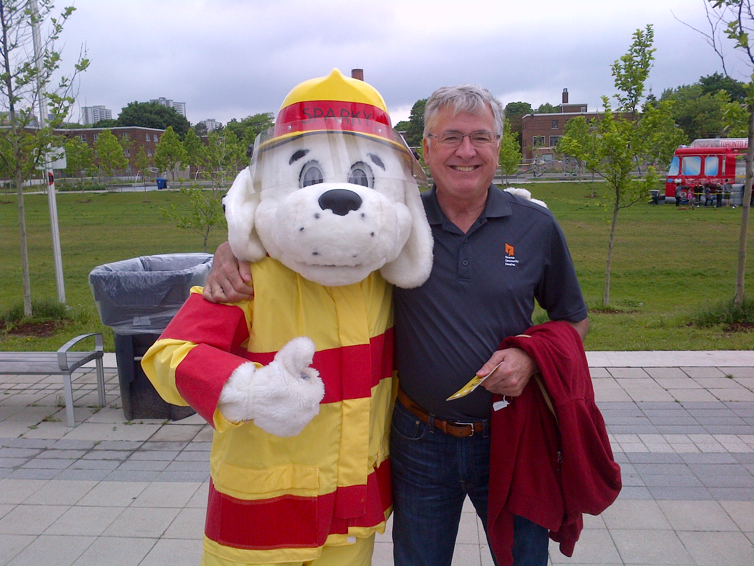 Sparky the fire dog and Greg Spearn, President and CEO (Interim) posing for the camera