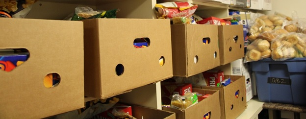 A photo of boxes of food on shelves.
