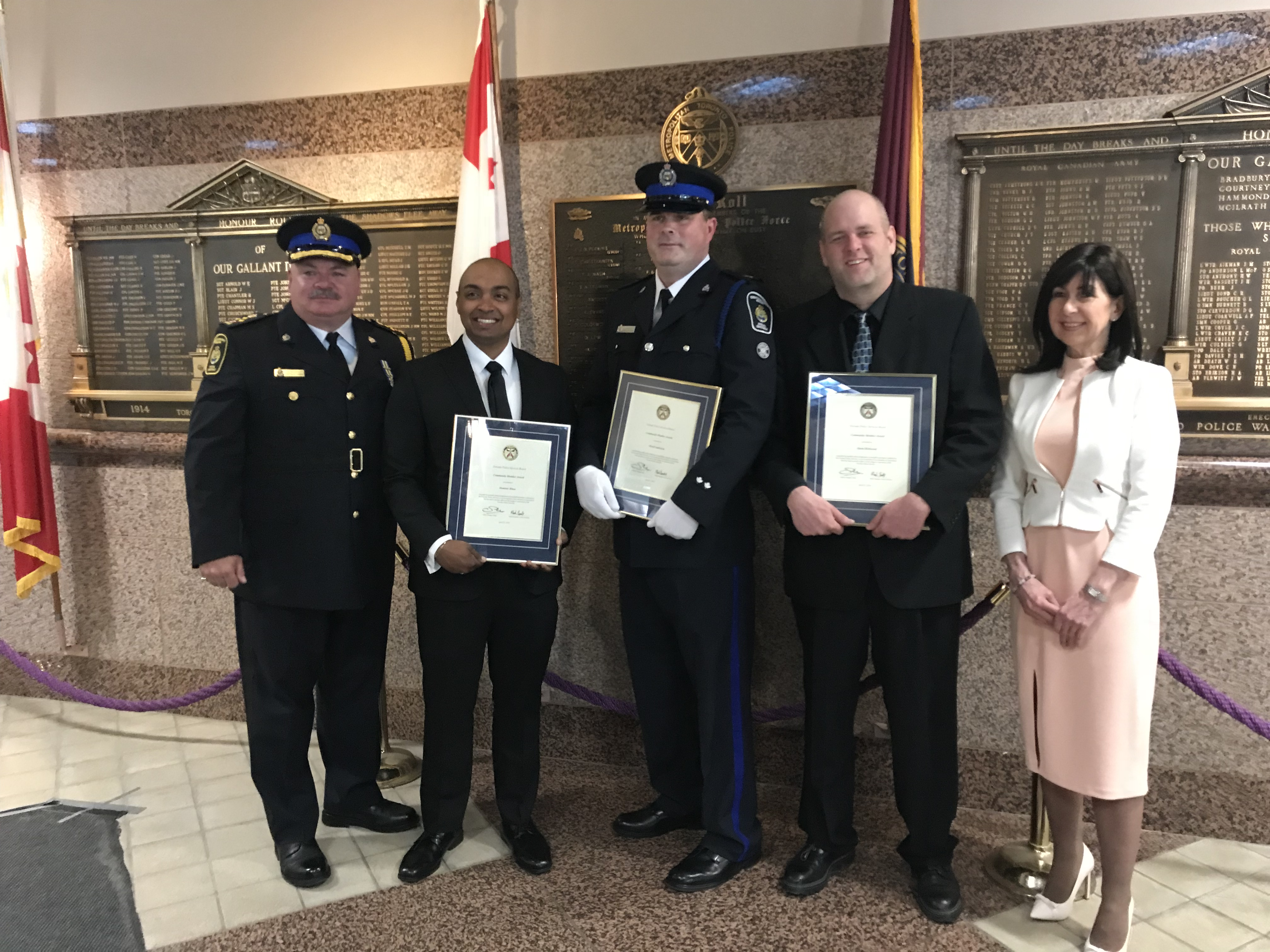 Group photo of three Community Safety Unit Special constables holding awards, next to the CSU Senior Director and TCHC CEO