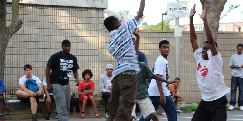 A young resident of Netune makes a jump-shot during the community basketball tournament