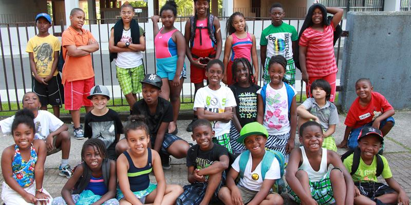 Boys and girls from Kingston Galloway receiving their new swimsuits
