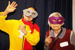 Two older women wearing a masks to cover their faces.