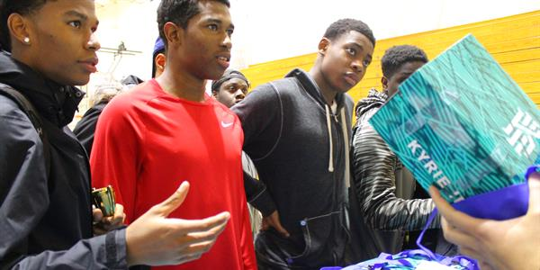 Youths recieve Kyrie Irving shoes from Nike Canada