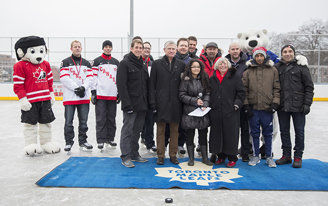Bud Purves, MLSE staffand Hockey Canada mascot pose for a picture on the new ice rink