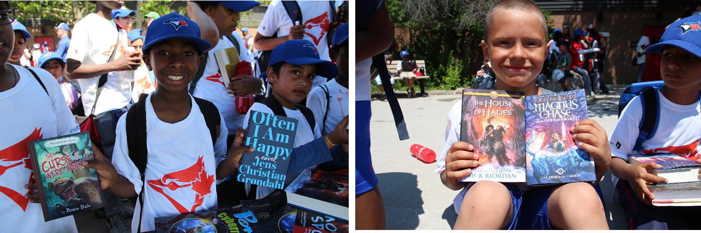 Campers show off the two books they got to take home, thanks to First Book Canada.
