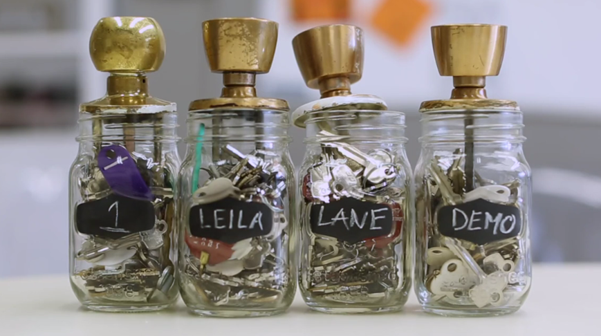 Image of jar of keys with 1 Leila Lane written on them.