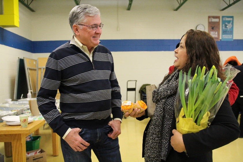Image of resident Norma Gomez speaking with Toronto Community Housing President and CEO (Interim) Greg Spearn.
