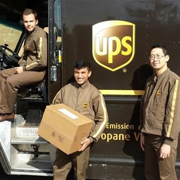 Three UPS employees working during their work shift.