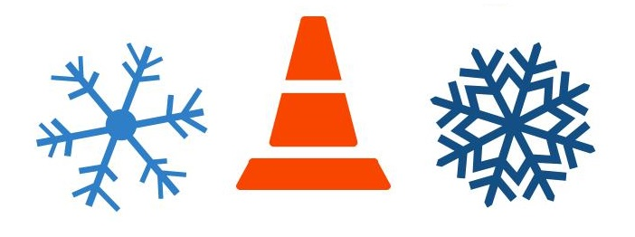 Snowflakes and traffic cone