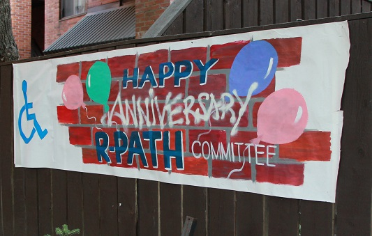 The R-PATH anniversary banner, hand-painted by a Toronto Community Housing resident