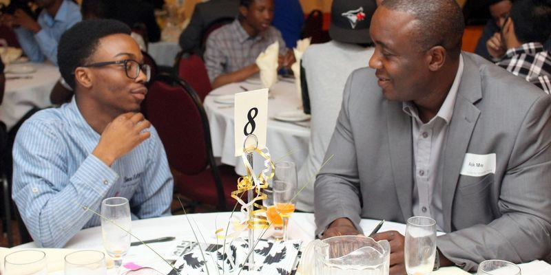 A young participant chatting with a mentoring session with Mike Morgan