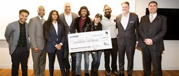 A photo of alid Musse, flanked by Be.Build.Brand. alumnus Michael Gezahegn (left); judges (from 2nd left: JR Thomas, Meher Kaur